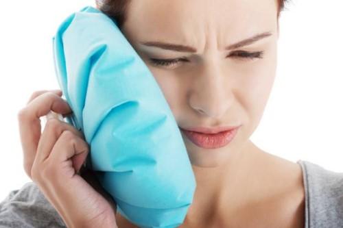 cách giảm đau nhức sau khi nhổ răng
