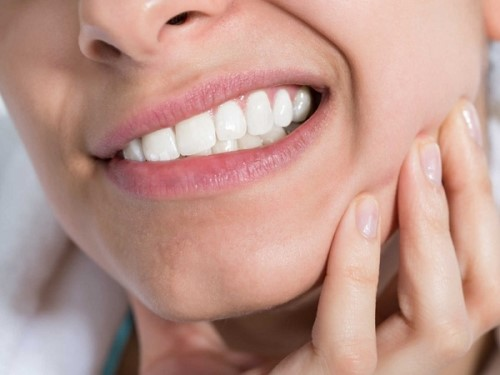 đau nhức khi mọc răng khôn