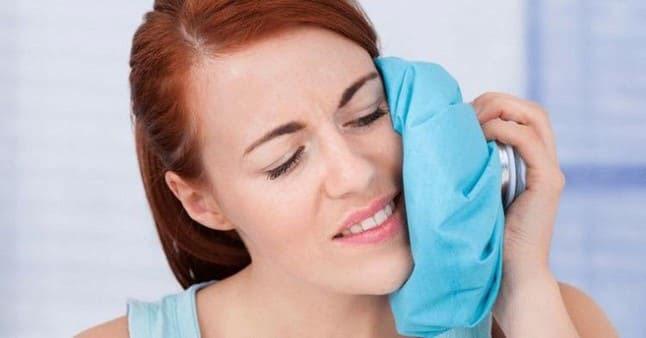 nhổ răng đau không